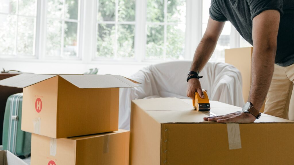 Man packing a moving box